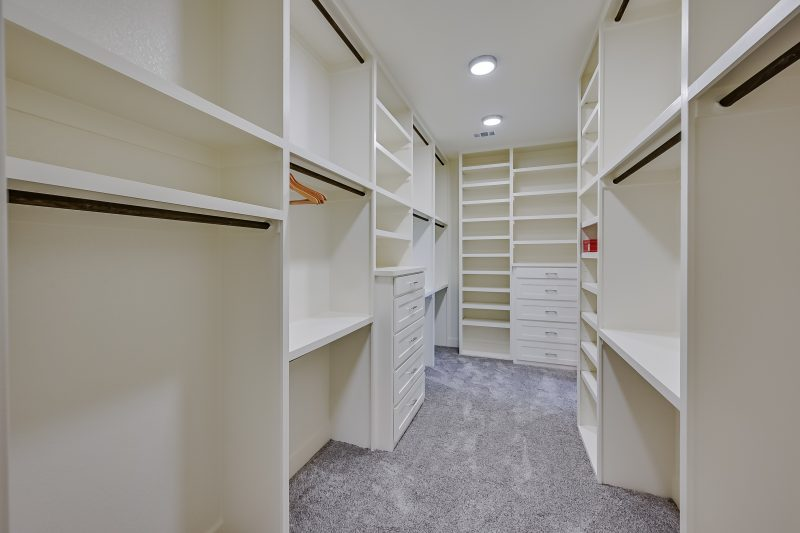 Design Considerations for Your Custom Home's Master Walk-In Closet
